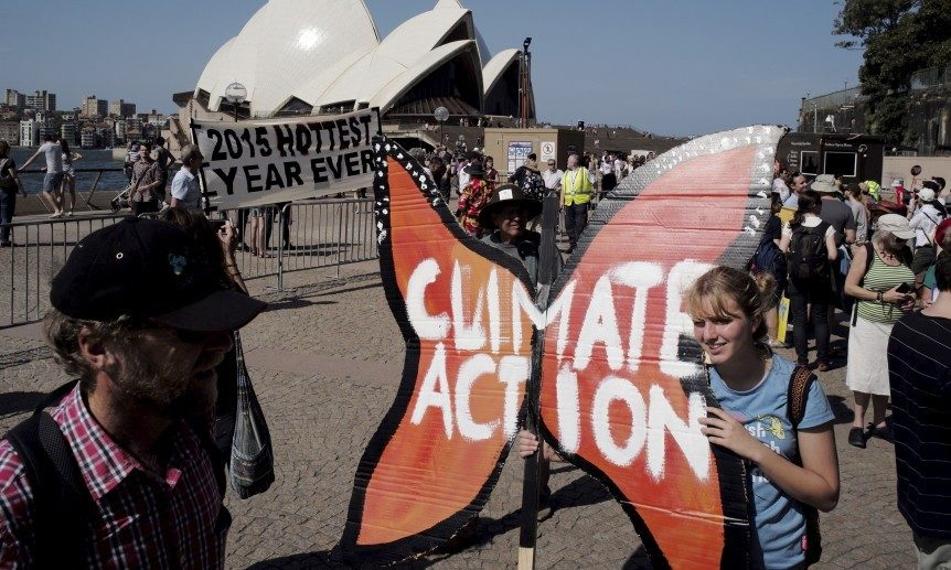 Protester Amy Walburn holds a butterfly-shaped placard in front of the Sydney Opera House during a rally held ahead of the 2015 Paris Climate Change Conference, known as the COP21 summit, in Sydney's central business district, Australia November 29, 2015. REUTERS/Jason Reed